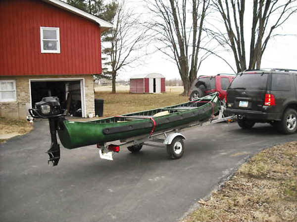 Trailex SUT-200-S Trailer Shown with Sportspal S-15 Canoe and Outboard