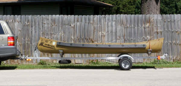 Trailex SUT-200-S  Trailer  with a 13 ' Square Stern Sportspal Canoe