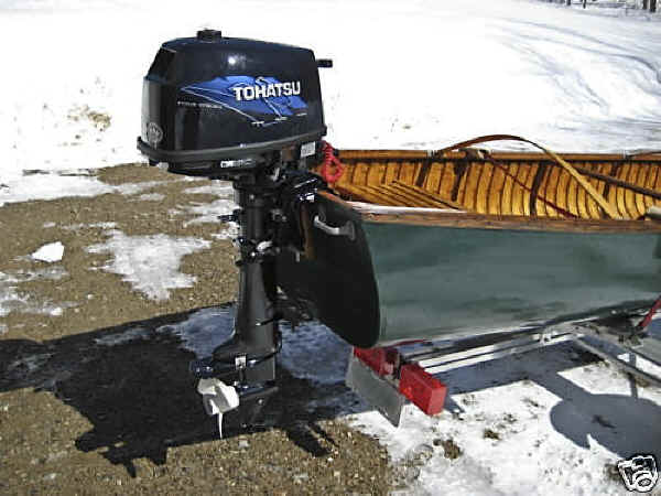 Trailex SUT-200-S Trailer Shown With Wood Canvas Canoe and Mounted Motor